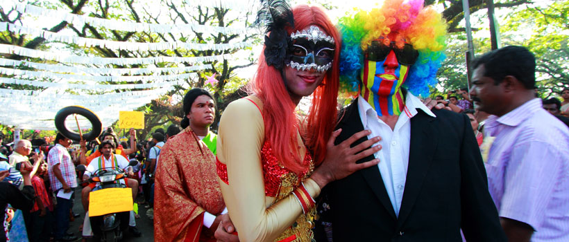 An unidentified couple wear carnival masks during the Cochin Carnival New Year's day celebration in Fort Kochi