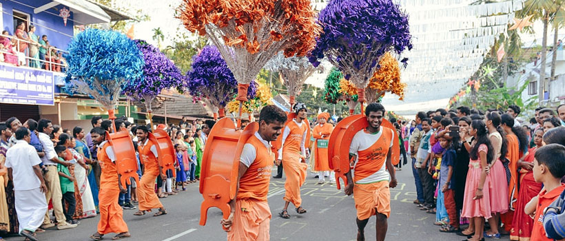 Participants of New Year carnival in festival costumes on the streets of Fort Kochi.