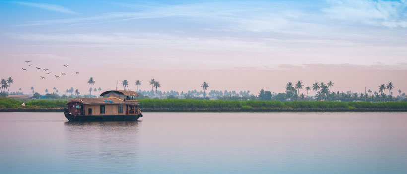A beautiful view of Alleppey backwaters with houseboat