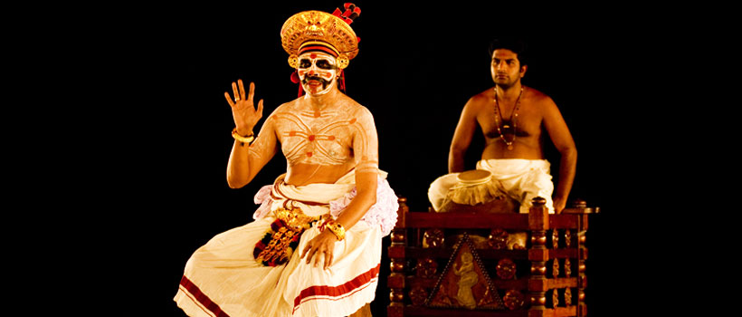 Artist performing Chakyar Koothu in a stage.