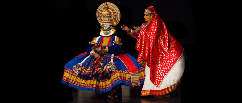 Kathakali performer in the virtuous pachcha (green) role in Kerala Village Fair at Kovalam