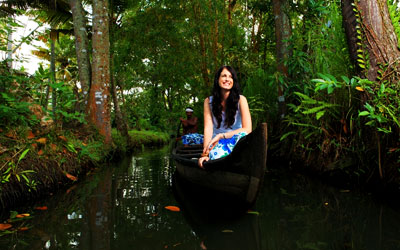 A young women enjoying canoe ride in Kerala during February