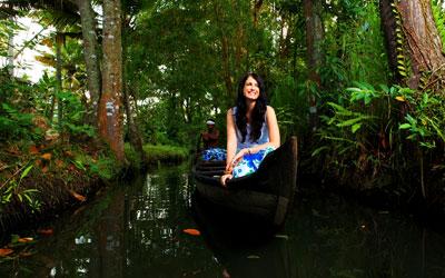 A young women enjoying canoe ride in Kerala during February
