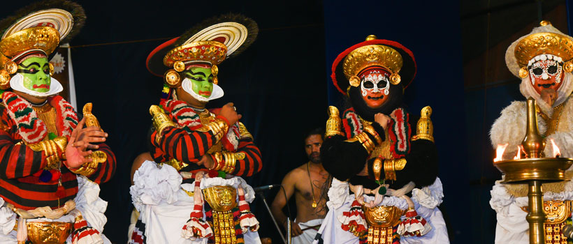 Koodiyattam or Kutiyattam folk art performed with traditional face painting in temples of Kerala, India.