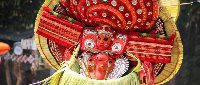 A Theyyam artist performing during the festival at Arathil Bhagavathi Temple in Kannur,