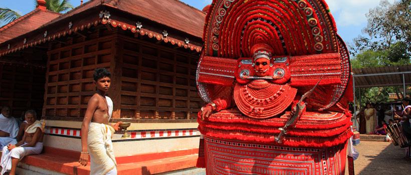 An unidentified Theyyam artist performs at Kadannappalli Muchilot Bhagavati temple