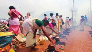 Women devotees offering the pongala ritual on the occasion of 'Attukal Pongala'.