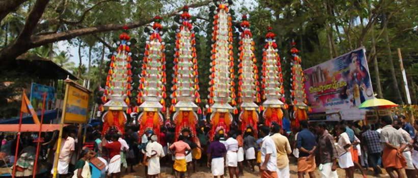 kaavadiyattam or burden dance is ceremonial sacrifice of devotees during worship of hindu lord murugan.
