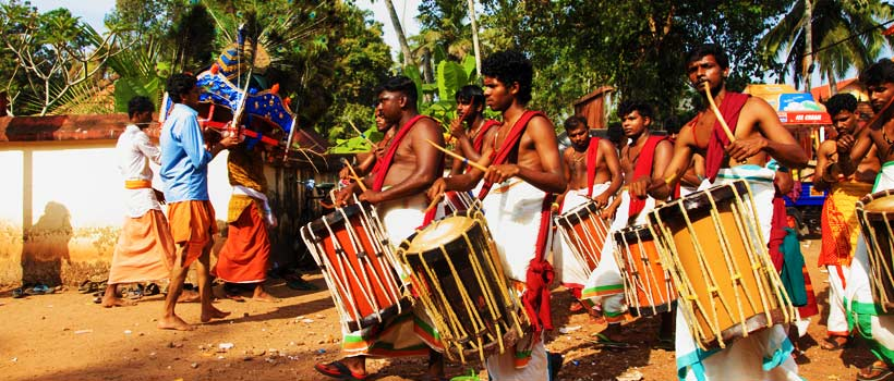 Devotees holding the decorated kavadi and dance in frenzy with Chenda melam during the Thaipuyam festival at the Haripad Subramanya temple