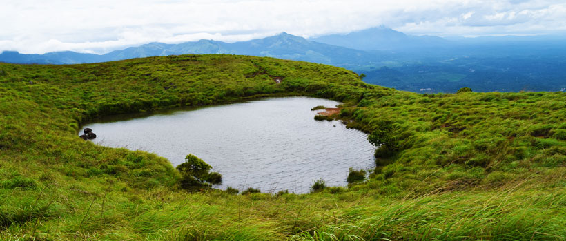 A beautiful view of Wayanad heart shape lake in Chemabra peak