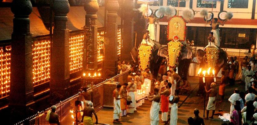 "A glimpse of Guruvayur temple elephants decorated with a distinctive golden head covering called a ""Nettipattam"""